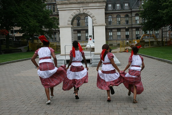 girls in national dress running